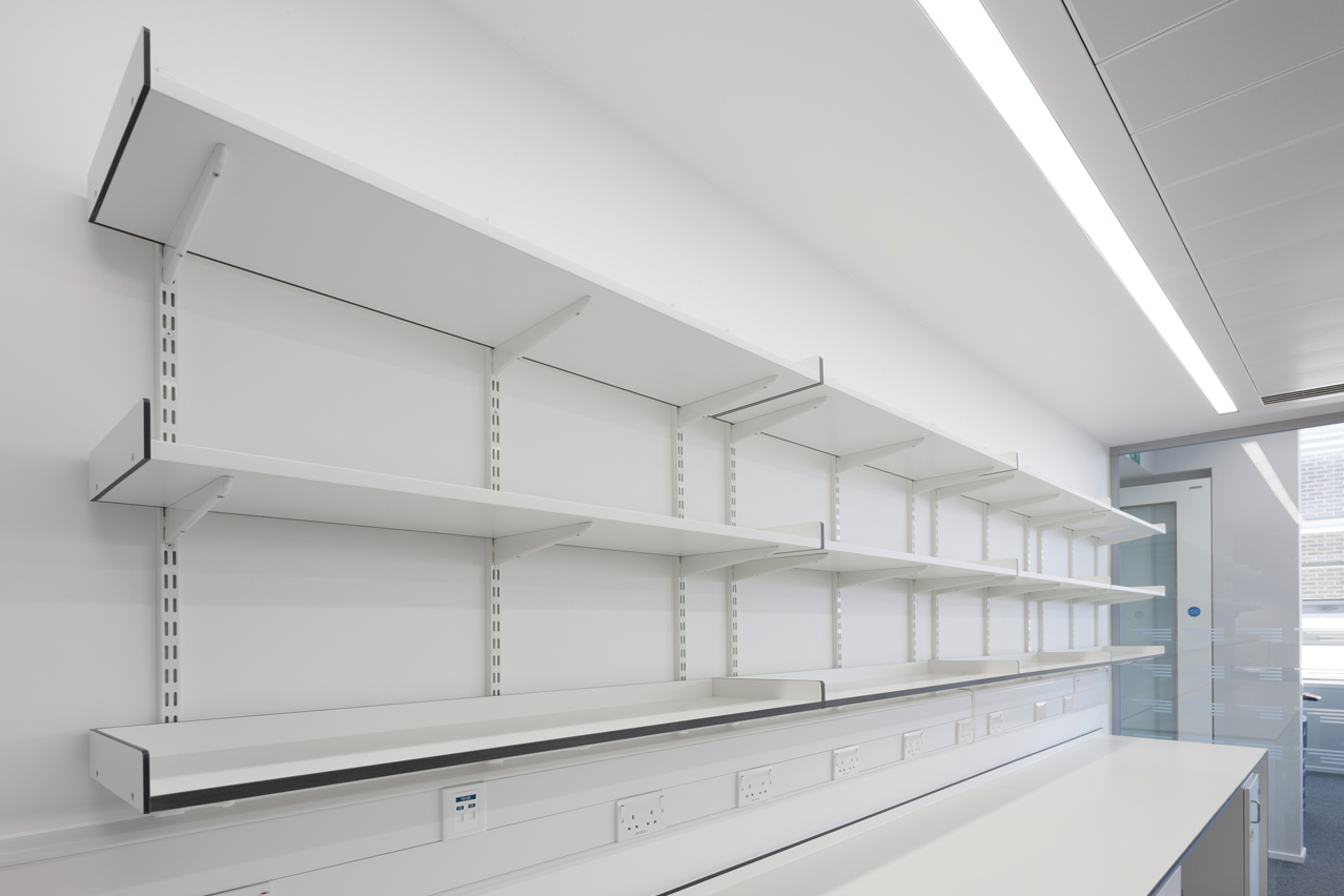 Wall mounted fully adjustable slotted shelving system